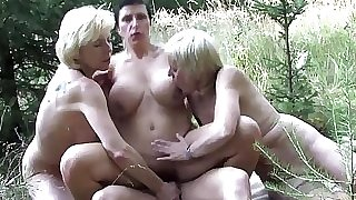 Mature ladies sharing a young fellow outdoor