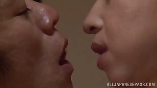 mature asian jerks off a dick like a pro